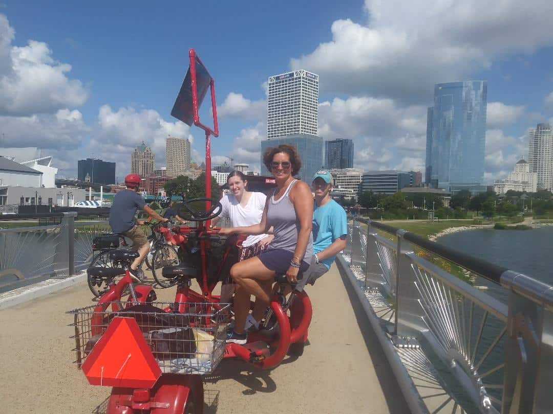 Seven Seat Bike Riders on Bridge for Downtown Milwaukee Tour - Milwaukee Seven Seat Bike Tours